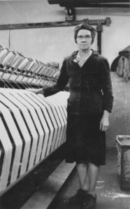 Image of Margaret Millar stood by a winding frame, 3 May 1954 DUNIH 102