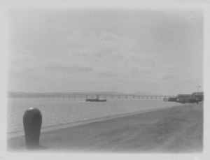 Image of Tay Rail Bridge with boat in foreground DUNIH 2009.26.17