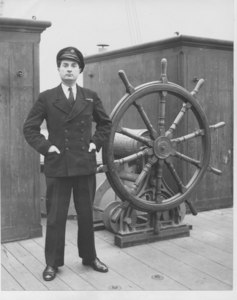 Image of Scout at the ship's wheel DUNIH 2010.11.1