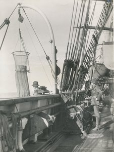Image of Alister Hardy and F.C Fraser operating plankton net on deck of Discovery DUNIH 2017.2.48