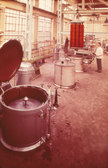 Image of Man using dyeing vats at Tay Carpet Works DUNIH 2006.1.12.3