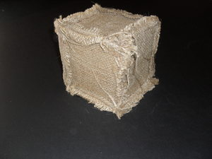 Image of Cube covered in jute fabric. DUNIH 2011.1.78