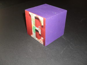 Image of Cube embellished with the letter 'E' DUNIH 2011.1.80.4