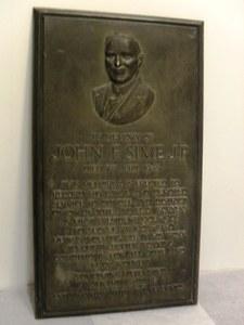 Image of Bronze plaque in memory of John F. Sime DUNIH 2014.6