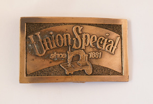 Image of Belt Buckle advertising Union Special Sewing Machines DUNIH 2017.17.2